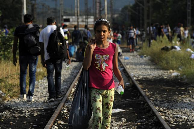 A migrant girl walks on the train tracks near the village of Idomeni at the Greek-Macedonian border, August 20, 2015.  REUTERS/Alexandros Avramidis